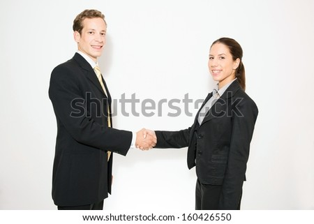 Business dressed male and female model,in different role plays.