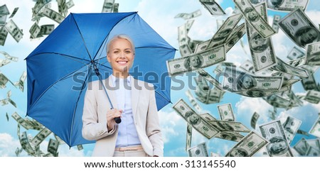 business, economy, finances and people and concept - happy young businesswoman with umbrella over blue sky and clouds background - stock photo