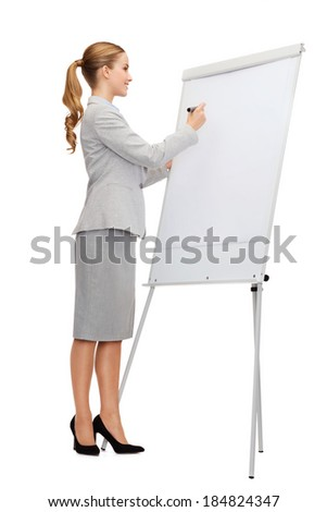 business, education and office concept - smiling businesswoman writing on flip board