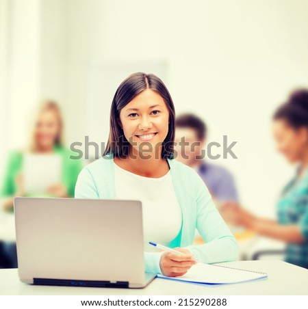 business, education and technology concept - asian businesswoman or student with laptop and documents in office - stock photo