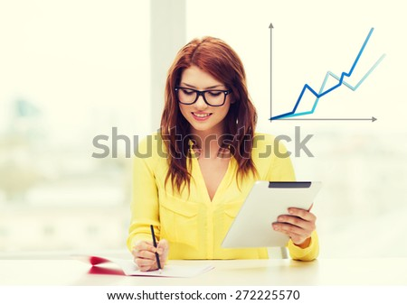 business, education and technology concept - smiling student in eyeglasses with tablet pc computer and notebook in college - stock photo
