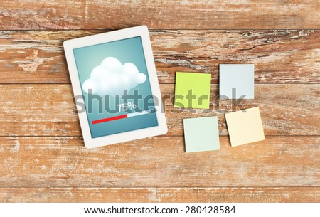 business, education, cloud computing and technology concept - close up of stickers and tablet pc computer transferring data on table - stock photo