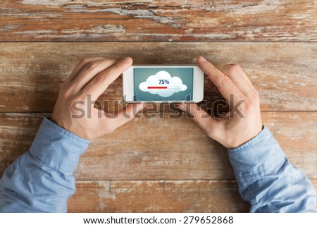 business, education, cloud computing, people and technology concept - close up of male hands smartphone transferring data - stock photo