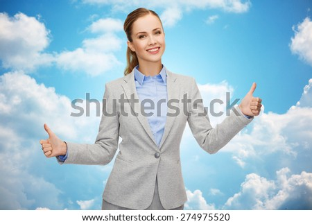 business, education, gesture and people concept - smiling businesswoman showing thumbs up over blue sky and clouds background - stock photo