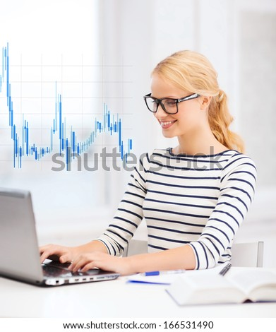 business, education, money and new technology concept - smiling student with laptop, book, computer, notebook, eyeglasses and forex chart - stock photo