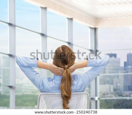 business, education, people and office concept - businesswoman or teacher sitting on chair from back over office window background - stock photo
