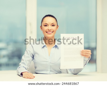 business, education, school, legal and real estate concept - happy businesswoman holding contract in office
