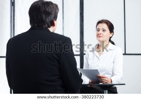 business enthusiastic woman interviewing a man for a job - stock photo