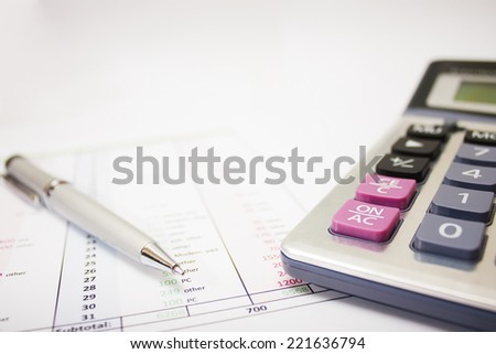 business environment. gray ballpoint pen, printed document and a large calculator on the table. Closeup. - stock photo