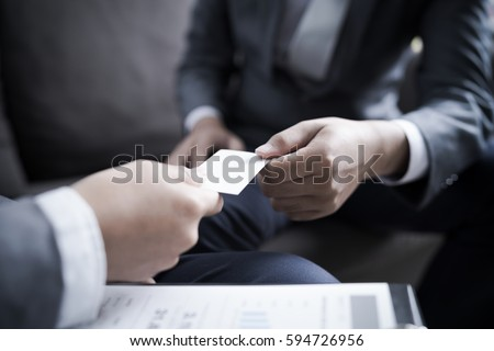 Business executive exchanging business card stock photo royalty business executive exchanging business card colourmoves