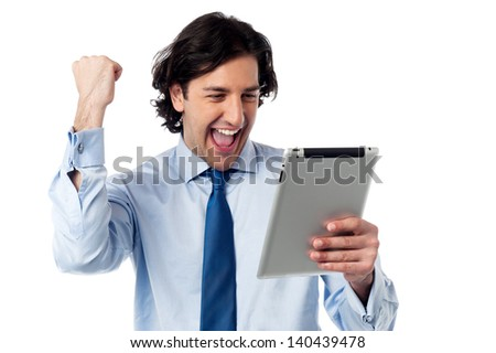Business executive holding touch pad. Full of enthusiasm. - stock photo