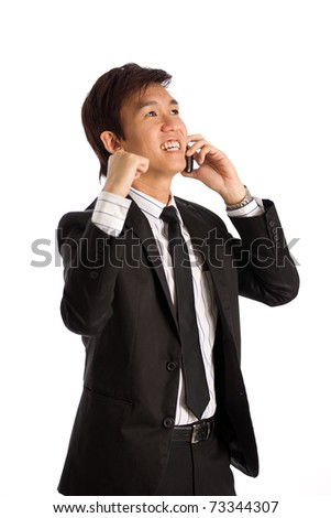 Business executive in corporate setting on phone - stock photo