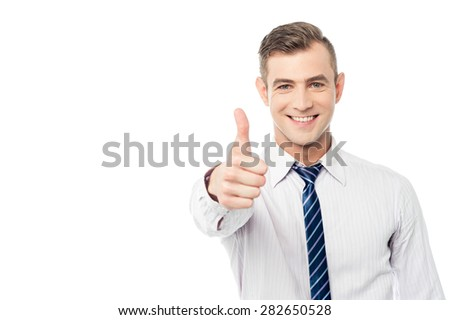 Business executive showing thumbs up gesture - stock photo