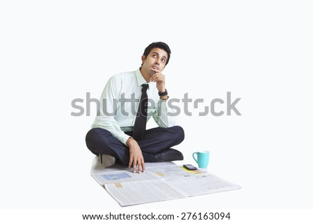 Business executive thinking - stock photo