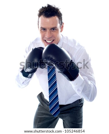Business executive wearing boxing gloves. Ready to fight - stock photo