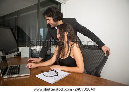 Business executives at the office working on the computer - stock photo