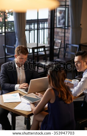 Business executives having meeting in cafe