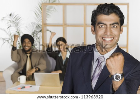 Business executives showing fist and smiling - stock photo