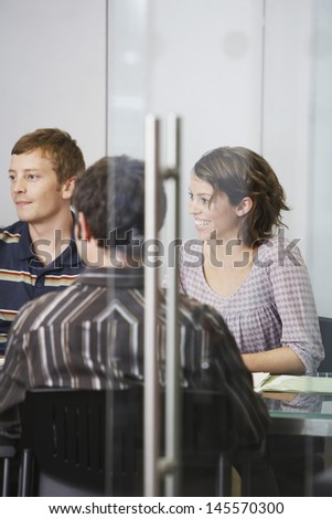 Business executives sitting around conference table