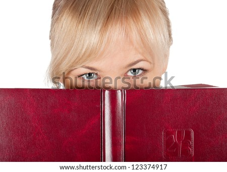 Business eyes over red notebook on a white background.