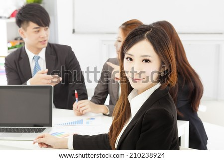 business female manager with teams in the office - stock photo