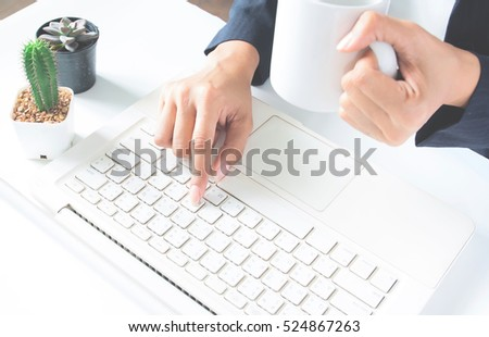 Business female using laptop. Technology and officer concept