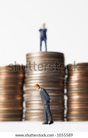 Business figure with coins - stock photo