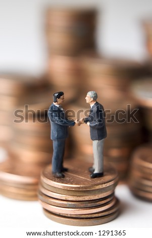 Business figures and money - stock photo