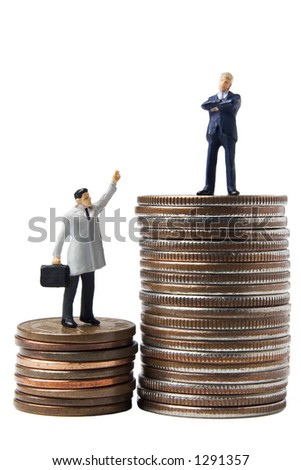 Business figures on a stack of coins - stock photo