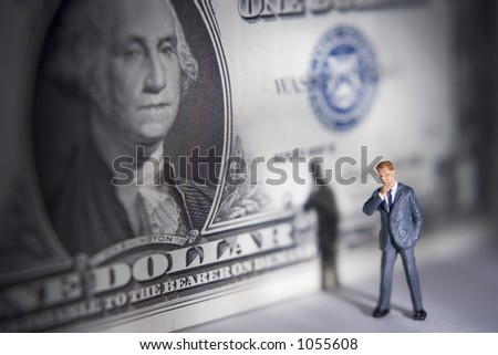 Business figures with a dollar - stock photo