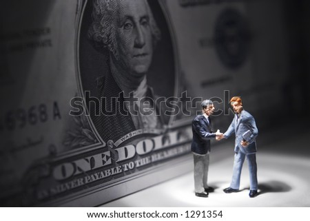 Business figures with money - stock photo