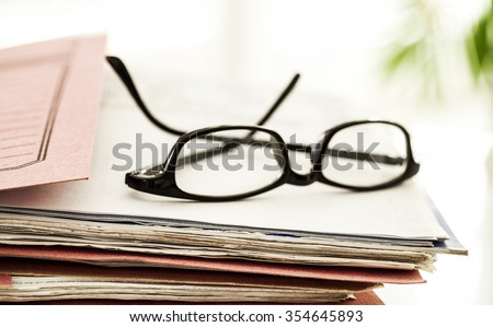 Business file and eyeglasses