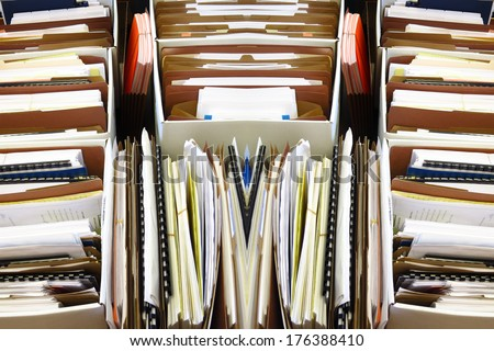 Business files arranged and organized in boxes folders - stock photo