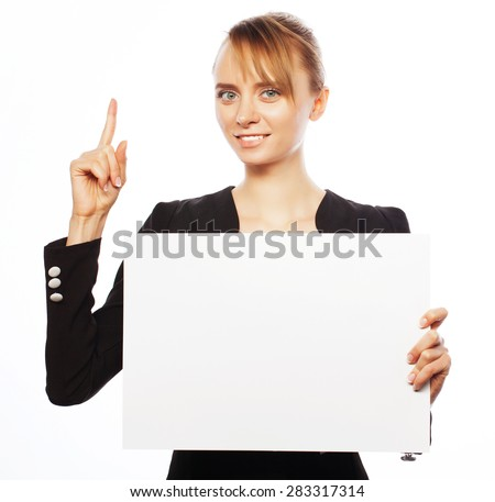 Business, finance and people concept: happy smiling young business woman showing blank signboard, over white background  - stock photo