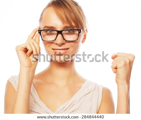 Business, finance and people concept: young business woman in glasses - stock photo