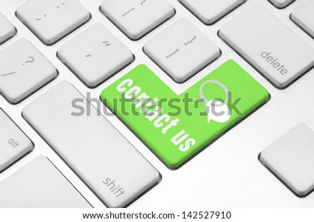 Business finance concept: Contact us key on the computer keyboard - stock photo