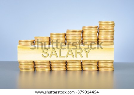 Business finance concept; golden coin graph and piece of wood with carved word salary  .