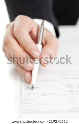 Business finance man checking budget numbers with on printout documents - stock photo