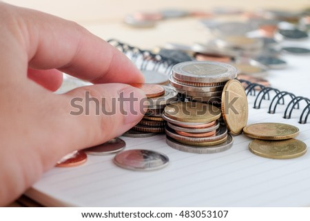 business finance. save money for investment concept  coins baht thai and hand
