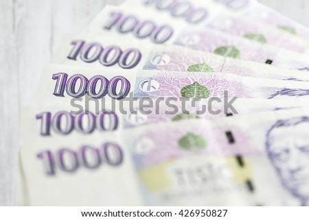business, finance, saving and cash concept - close up of czech paper money  on table