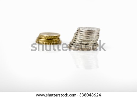 business, finance, saving and cash concept - close up of euro coins on table, selective focused - stock photo