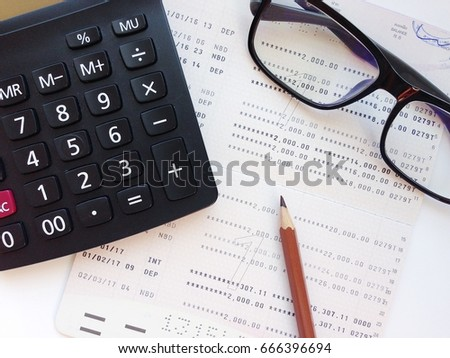 Business, Finance, Savings, Banking Or Loan Concept : Pencil, Calculator,  Eyeglasses