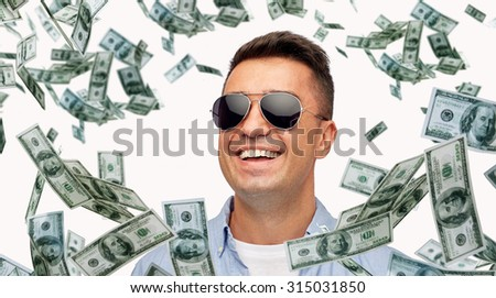 business, finance, success and people concept - face of smiling middle aged latin man in shirt and sunglasses with heap of falling dollar money - stock photo