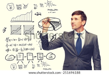 business, finances, economics and office concept - attractive buisnessman drawing plan on virtual screen - stock photo