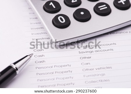 business financial analysis (saving) with pen  & calculator