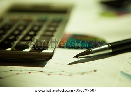 Business financial charts and graphs on the table.