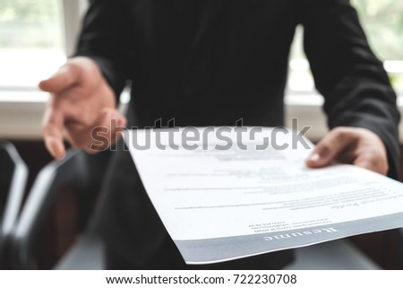 Business find new job, interview the job and hiring. Job applicant holding resume.Open handshake and resume job interview or acceptance