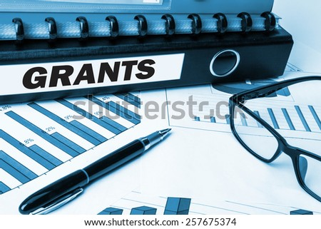 business folder with label grants - stock photo