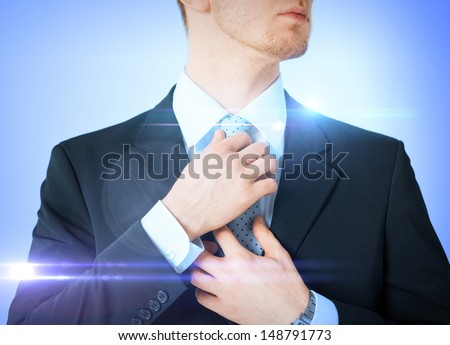 business, formal clothes and dating - man adjusting his tie