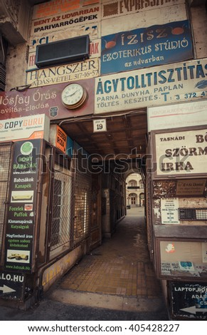 Business from the past - Budapest, Hungary - Mars 31, 2016: Vintage business signs for different shops on a wall at the entrance of old shopping galleries in Budapest city, Hungary.
